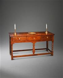 A small George III oak dresser base