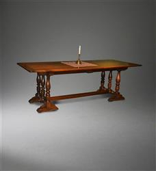 A fine Italian walnut trestle table.