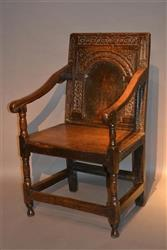 A Charles I oak wainscot chair.