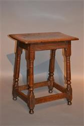 An elegant Queen Anne oak joint stool.