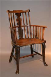 A George III comb back Windsor armchair.