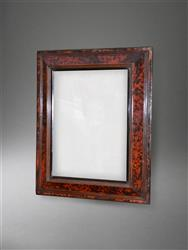 An 18th century tortoiseshell frame mirror.