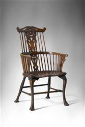 An extremely rare 18th century comb-back armchair.