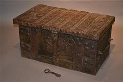 A 15th/16th century oak and iron strongbox.