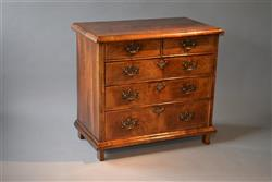 A Queen Anne walnut chest of drawers.