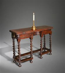 A charming 17th century oak writing table.