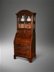 A very small George I oak bureau bookcase.