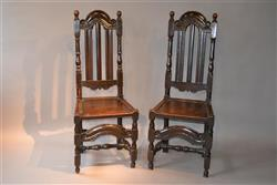 A fine pair of William III oak high back chairs.