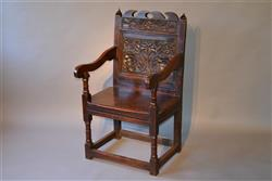 A North Country Charles II oak armchair.