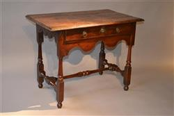 A Queen Anne fruitwood side table.