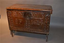 A small and rare boarded chest dated 1624.
