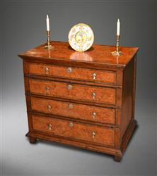 A William and Mary burr elm chest  of drawers.
