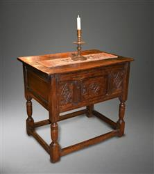 A mid 17th century oak table cupboard.