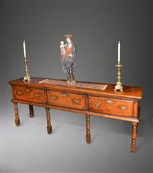 An early 18th century fruitwood low dresser.