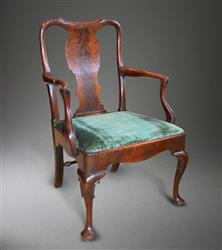 An early George II walnut armchair.