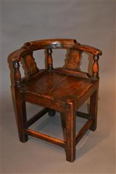 A George III elm child's corner chair in elm.