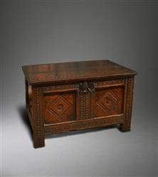 An exceptionally small mid 17th century oak chest.