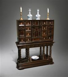A late 17th century ebony cabinet on stand.