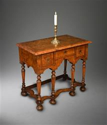 A Queen Anne burr elm lowboy.