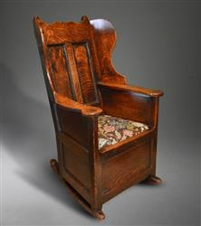 A George III oak lambing chair.