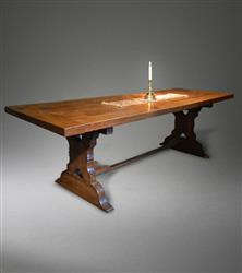 A mid 18th century oak and ash trestle table.
