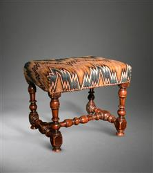 A fine Queen Anne walnut upholstered stool.