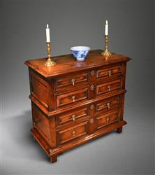 A James II yew wood chest of drawers.