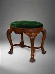 A Irish George I walnut oval stool.