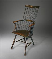 A George III comb back armchair.