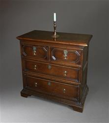 A small Queen Anne oak chest of drawers