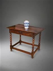 A Charles II oak side table.