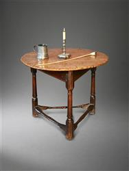 A wonderful Charles II oak tavern table.