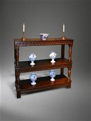 A mid 17th century oak three tier buffet.