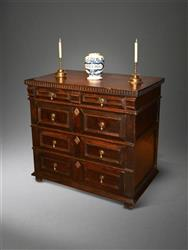 A Charles II walnut chest of drawers.
