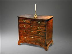 A small George I burr oak chest of drawers.