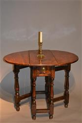 A very small Queen Anne gateleg table.