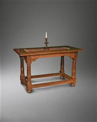 An Elizabethan oak communion table.