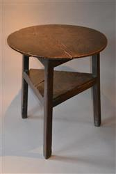 An early 18th century oak cricket table.