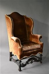 An elegant William and Mary wing chair.