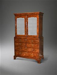 A George II walnut secretaire cabinet on chest.