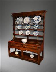 A small 18th century potboard dresser and rack.