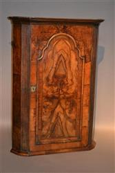 A fine George II walnut corner cupboard.