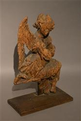 A weathered 15th16th century oak angel.