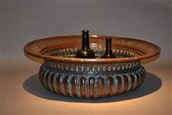 A large 17th century Italian copper wine cistern.