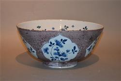 A large early 18th century English delft bowl.