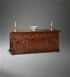A Queen Anne oak cupboard low dresser.