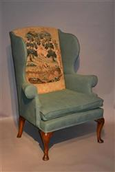 A George II wing armchair.