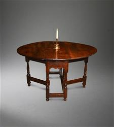 An early 18th century yew wood gateleg table.