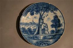 A charming 18th century delft apple picking plate.