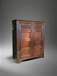 A stunning Charles I oak press cupboard.